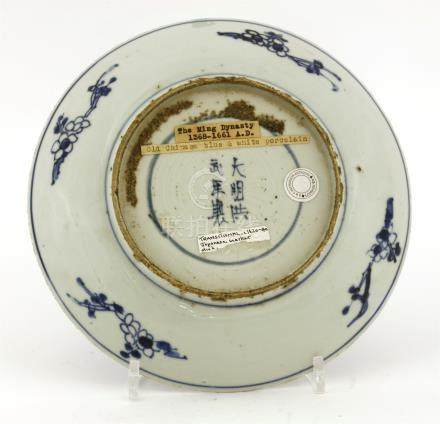 A Chinese blue and white dish, late Ming dynasty, the centre painted with chrysanthemum encircled ...