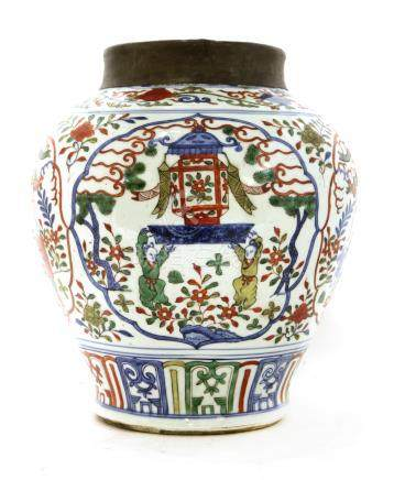 A Chinese wucai pot, of baluster form, painted with boys carrying a lantern in shaped panels ...