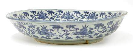 A Chinese blue and white charger, Jiajing (1522-1566), heavily potted and of shallow tapering form ...