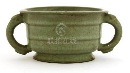 A Chinese ge-type celadon censer, Ming dynasty (1368-1644), of circular form with an everted mouth ...