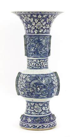 A Chinese blue and white altar vase, Wanli (1573-1620), of globular form with a tapering mouth and ...