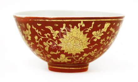 A Chinese copper red glazed bowl, Jiajing (1522-1566), of tapering form on a raised circular foot, ...