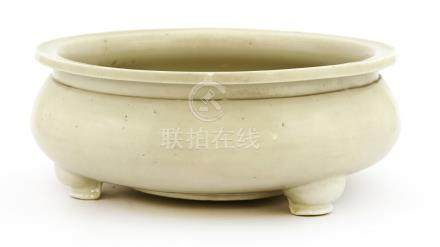 A Chinese Dehua ware censer, Kangxi (1662-1722), of squat globular form on three short feet, under ...