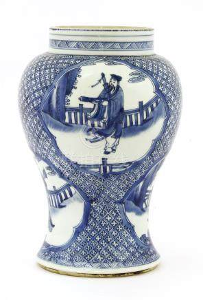 A Chinese blue and white vase, Kangxi (1662-1722), of baluster form, painted with Lü Dongbin, Li ...