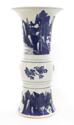 A Chinese blue and white beaker vase, probably Kangxi, painted with a man fishing from a boat on a ...