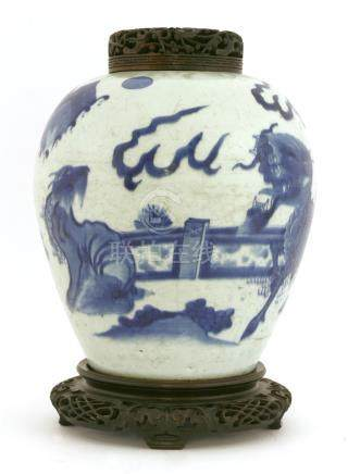 A Chinese blue and white ginger jar, Transitional period, painted with qilin and another mythical ...