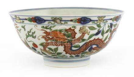 A fine Chinese wucai bowl, Kangxi (1662-1722), with deep rounded sides and a flared rim on a short ...