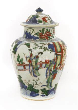 A Chinese Transitional wucai jar and cover, 17th century, of baluster form painted with figures in ...