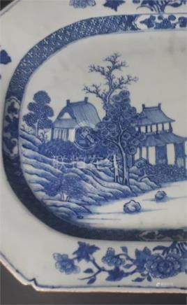 A Chinese Qianlong canted rectangular meat plate, painted in underglaze blue with pagodas amidst