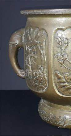 A late 19th century Japanese bronze twin handled jardiniere, with elephant trunk handles, the