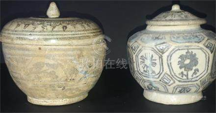 Two early Chinese pottery vases and covers, naively painted with stylised foliage, the tallest