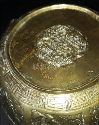A late 19th Century Chinese bronze octagonal bowl, with mask head handles, engraved to the sides