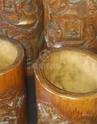 Four Chinese Qing dynasty carved bamboo brush pots, being two matching pairs, carvedwith figural