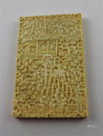 A Chinese Canton carved ivory card case, late 19th century, of rectangular form, profusely carved to
