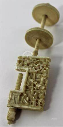 A Chinese Canton carved ivory sewing clamp, late 19th century, the clamp jaw deeply carved with