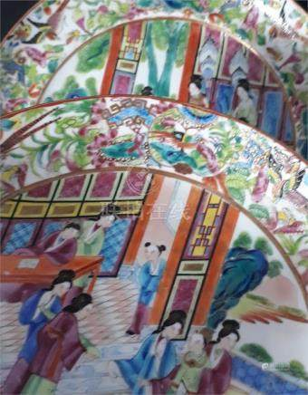 A Chinese Canton export famille rose plate, painted with figures within a bird and floral border,