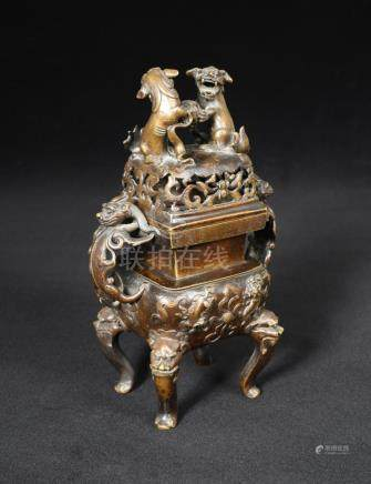 A Chinese square bronze censer, late Ming dynasty, with two dragon handles flanking the square