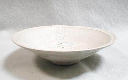 A Song dynasty dish, glazed on a white body, 24cm diameter