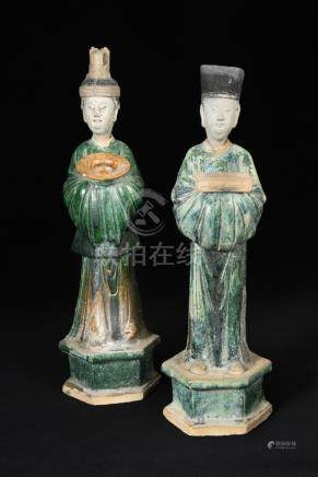 A pair of Ming dynasty attendants with removable heads, each standing on a hexagonal plinth, the