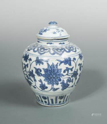 A Ming blue and white covered ovoid jar, with scrolling lotus band below ruyi lappets on the