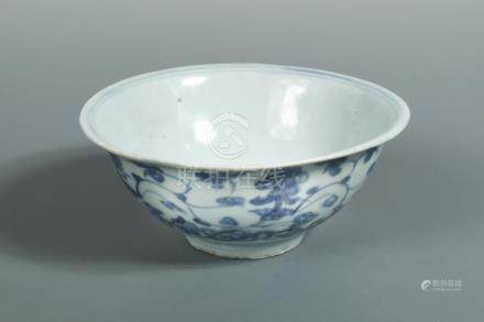 An early Ming blue and white bowl, the exterior painted with vine scrolling above ruyi lappets, 14.