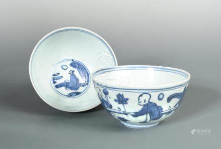 A pair of Ming blue and white bowls, painted in the centre with a seated sage watching the moon, the