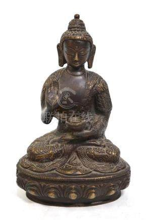 A metal sculpture of a Buddhist Deity, probably Amitabha or Amitayus, seated in typical dhyanasana