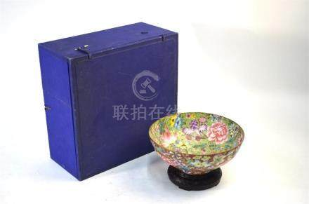A Chinese, famille rose 'egg-shell' bowl, decorated with a millefleurs design; 22 cm diameter, the
