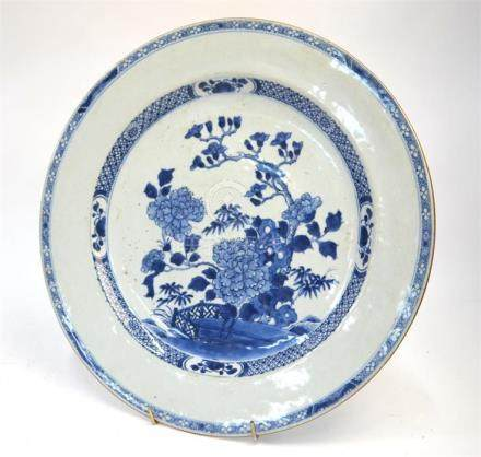 A Chinese blue and white, circular dish decorated with flowering peony in a garden, 34.5 cm