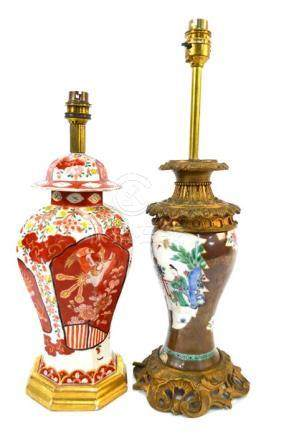 A gilt metal mounted, famille rose Chinese vase decorated on the cafe-au-lait ground with panels