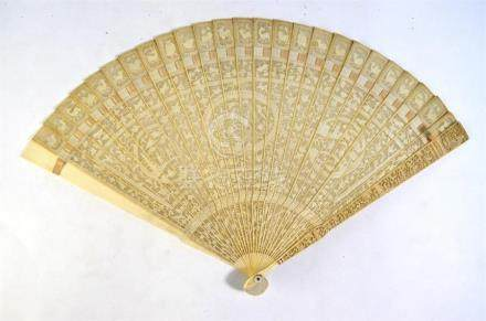 A 19th century Cantonese export carved ivory brise-fan finely-worked with monogram and oval