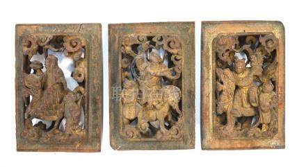 A set of three Chinese wood rectangular panels or applique; one decorated with the Daoist, Li