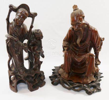 A Chinese hardwood carving of an seated elderly man, possibly a fisherman, 19cm high,