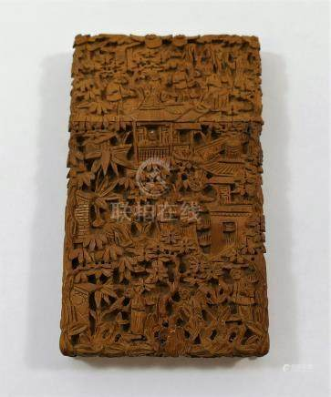 A Chinese carved boxwood card case, with all-over decoration of figures, pagodas and foliage, 9.