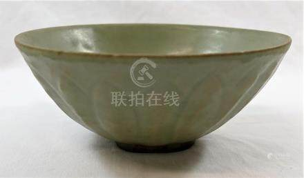 A Chinese celadon Song/Yang dynasty footed bowl, probably retrieved from a ship wreck,