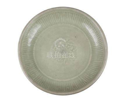 A Chinese grey stoneware Longquan celadon glazed bowl, Ming dynasty, 15th century, moulded with
