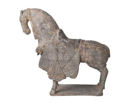 A Chinese finely modelled grey pottery figure of a caparisoned horse, Northern Wei Dynasty, standing