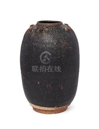 A Chinese stoneware black glazed jar, Song dynasty, of ovoid form, with studded decoration to