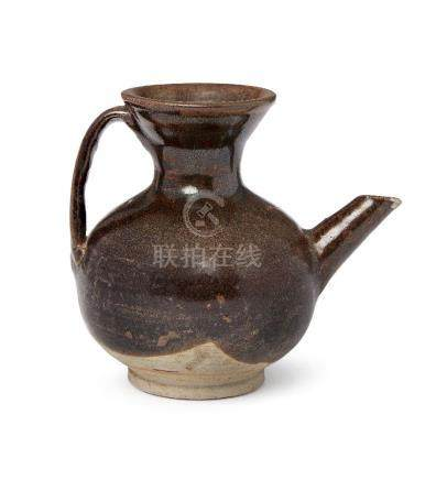A Chinese grey stoneware ewer, Yuan dynasty, with strap handle and angular spout, the dark brown