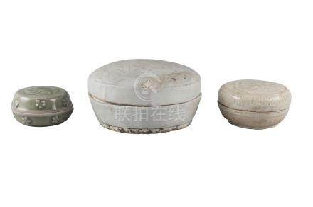 Three Chinese porcelain circular boxes and covers, comprising a Song dynasty qingbai glazed floral