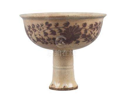 A Chinese provincial porcelain stem cup, Yuan dynasty, molded to the interior with two dragons,