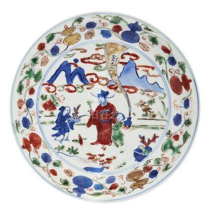 A Chinese porcelain wucai dish, Wanli mark and period, painted with a scholar and a boy being