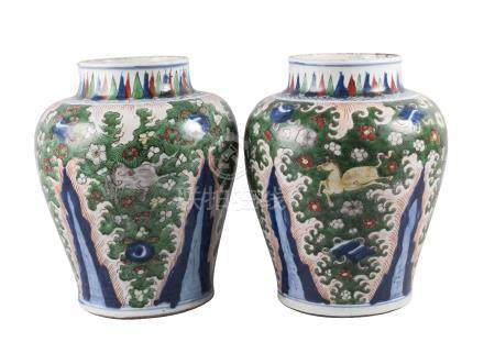A large pair of Chinese wucai porcelain vases, Transitional period, each painted in enamels with