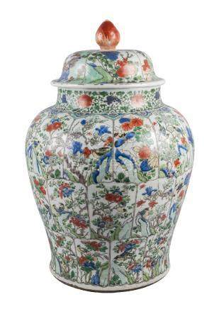 A large Chinese porcelain jar and cover, Kangxi, painted in famille verte enamels with three rows of
