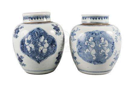 A pair of Chinese porcelain jars and covers, Kangxi, each painted in underglaze blue with quatrilobe
