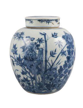 A Chinese porcelain jar and cover, 18th century, painted in underglaze blue with chrysanthemum and