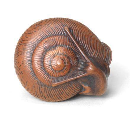 A wood netsuke of a snail By Masayoshi, Nagoya, Edo period (1615-1868), 19th century
