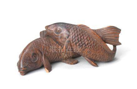 A wood netsuke of two carp Edo period (1615-1868), late 19th century