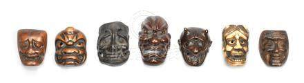 Seven mask netsuke of wood, stag antler and metal Edo period (1615-1868), late 18th/mid-19th century (7)