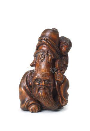 A wood netsuke of Fukurokuju and child By Ouchi Sosui (1911-1972), Showa era (1926-1989), 20th century (2)